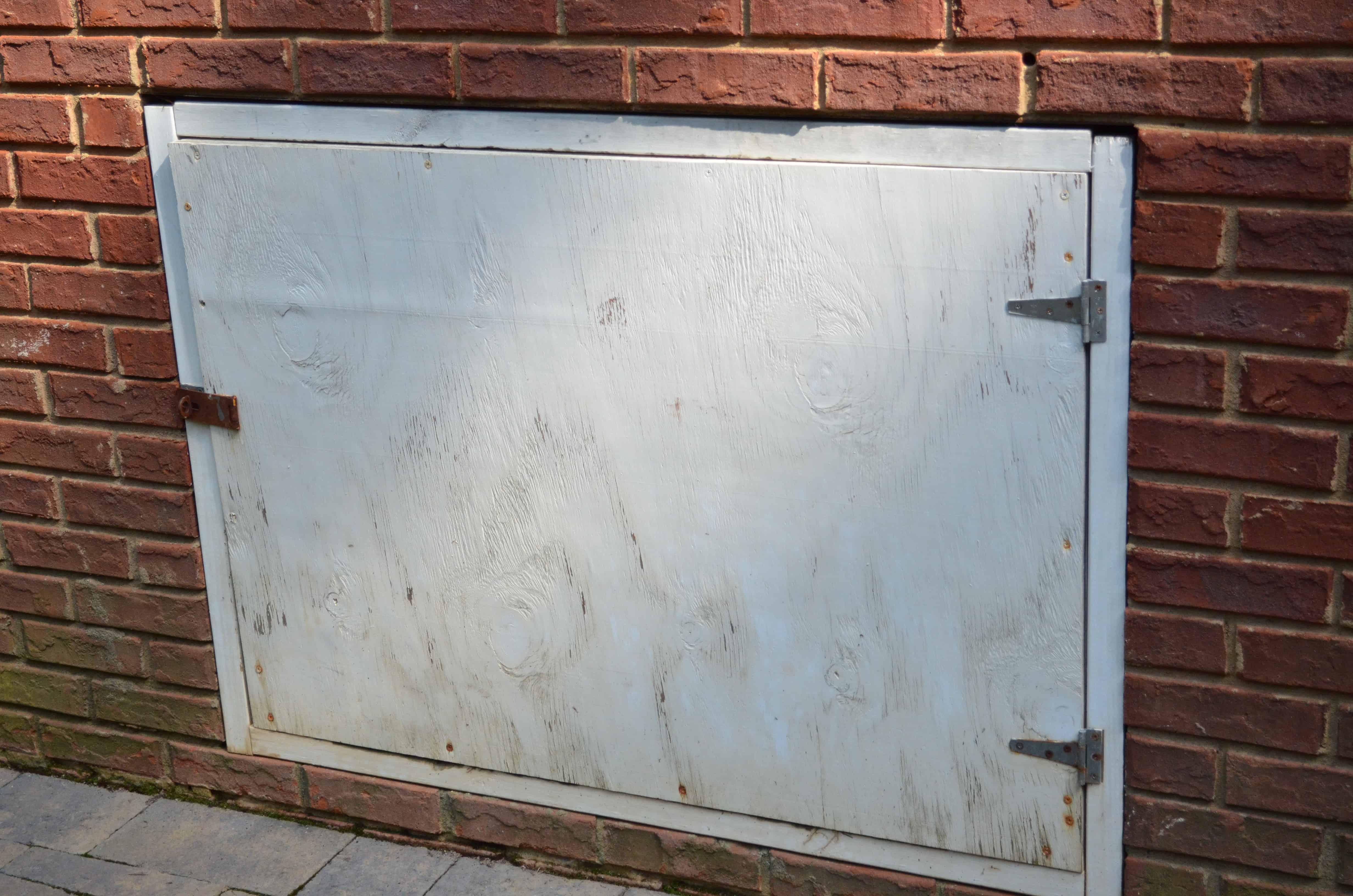 Interior crawl space door - Crawl Space Door Before