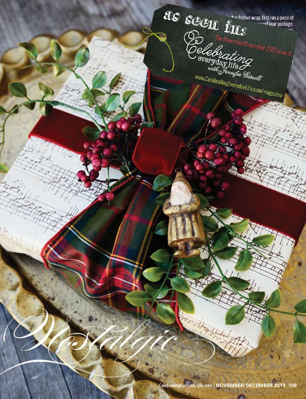 wrapping a beautiful Christmas present in paper with a velvet ribbon and santa ornament | Friday Christmas Favorites from www.andersonandgrant.com