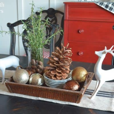 Dining Room Christmas Decor using Deer, metallics and pinecones