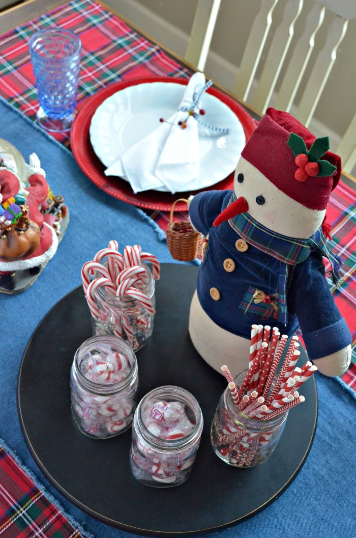 Christmas Table Setting with Snowman Centerpiece