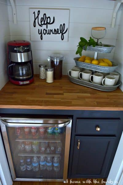 DIY Beverage Bar made with stock cabinets, chalky finish paint and butcher block