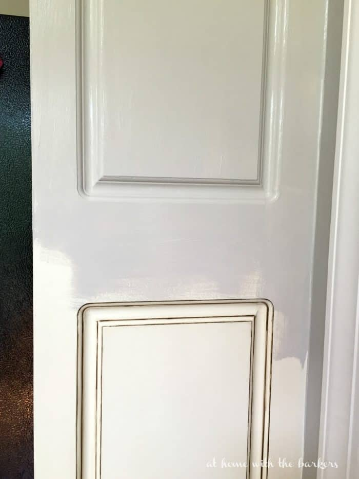 Painting Kitchen cabinets showing before and after progress