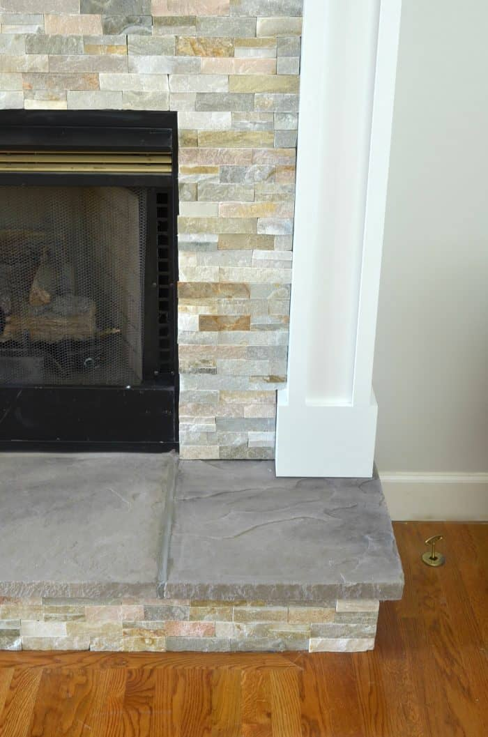This DIY fireplace makeover includes new stone tile