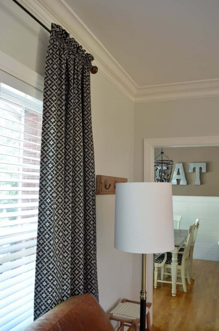 Sewing curtain panels allows for a budget friendly room makeover. One Room Challenge family room budget makeover.