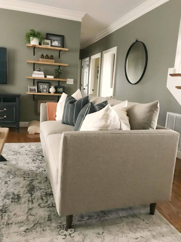 Bassett Furniture Modern Collection Ariana Sofa completes this living room makeover.