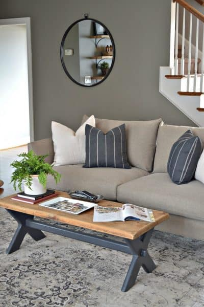 Living room makeover using modern sofa and vintage coffee table.