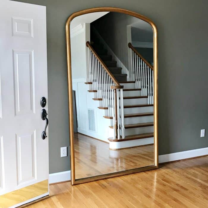 Statement mirror for the foyer creates a timeless look.