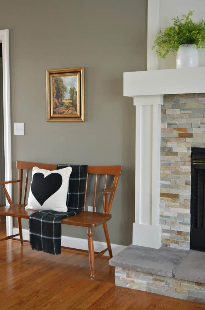 This living room makeover adds fun pieces into the decor like this heart pillow.