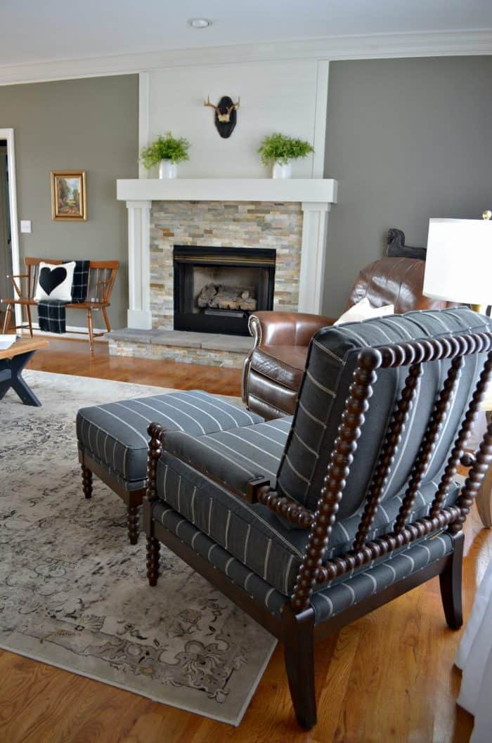 Classic chair and ottoman work perfect with the modern sofa.