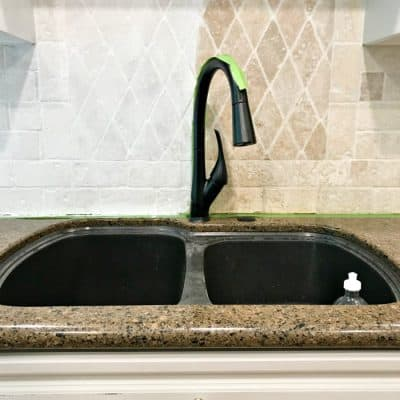 painted stone tile backsplash