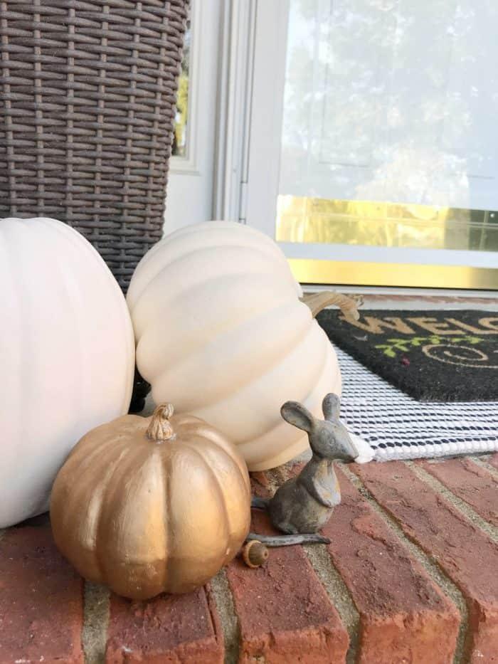 Fall porch faux pumpkins