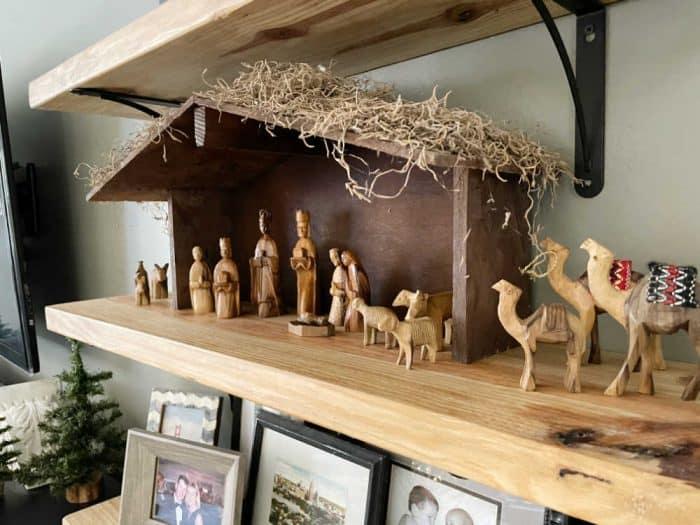 Manger decor on rustic shelf
