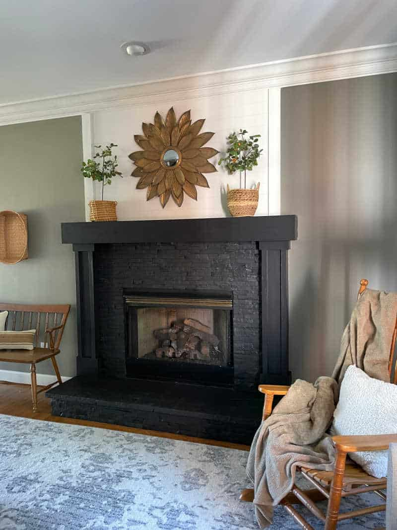 black magic by sherwin williams painted fireplace stone